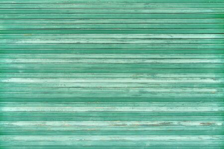 Green old weathered blind made of wood Stockfoto