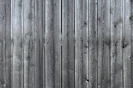 Gray wooden wall of a barn