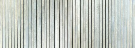 Panoramic detail of a bright, blue-gray wooden wall