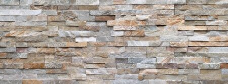 Stone wall made of bright facing stones - panoramic detail