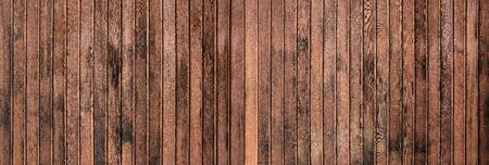 Weathered texture of a brown wooden wall - panorama