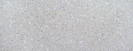 Bright, smooth concrete slab with pattern of colored stones