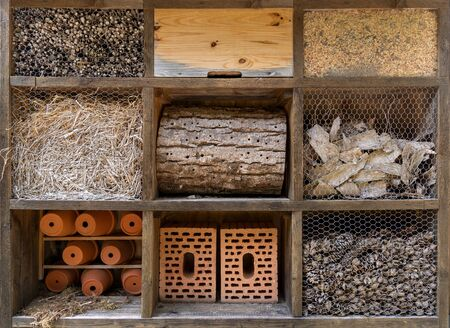 Large insect hotel with nine different compartments