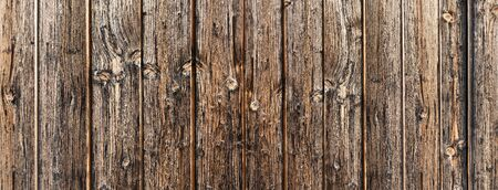 Detail of an old rustic weathered wooden wall