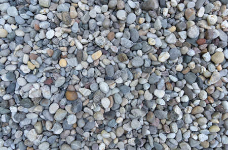 Area with small, different colored pebbles in top view close-up