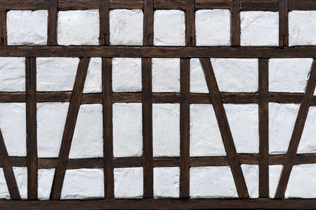 Half-timbered detail of a model building house in dark brown and white
