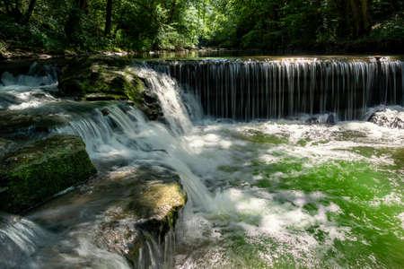 Cascades in an idyllic river in the forest - gorge Schlichemklamm near Epfendorf, Black Forest, Germany