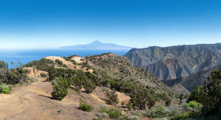 La Gomera above of Vallehermoso - hiking trail to the Buenavista in the picturesque mountain landscape with a view to Tenerife island