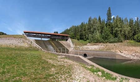 Dam Nagoldtalsperre, Black Forest, Germany - overflow with pedestrian bridge at the middle levee