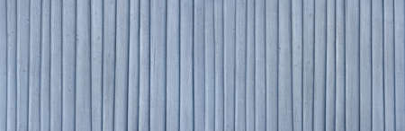 Plain light blue painted wooden wall with applied vertical strips - panoramic header image