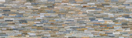 New wall made of colored facing stones - exterior architecture panoramic background