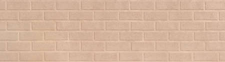 Design of a bright plaster facade imitating a stone wall - panoramic detail