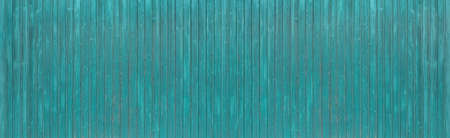 Turquoise blue painted, slightly weathered wooden wall made of vertical boards - panoramic background Foto de archivo