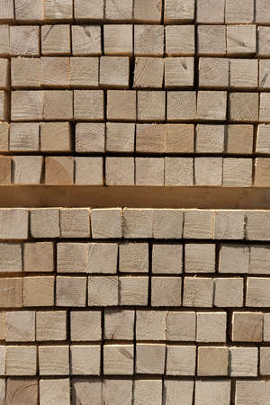 Stack of lumber in close-up - new square timber