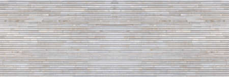 Panoramic wall detail of a new bright wood paneling made of narrow horizontal boards Foto de archivo