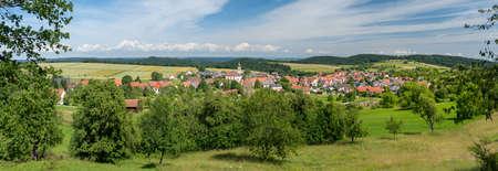 Idyllic village panorama in hilly rural landscape in summer - Erlaheim, district of Geislingen in Baden-Württemberg, Germany Foto de archivo