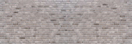 Panoramic brick wall background made of gray bricks in different shades Foto de archivo