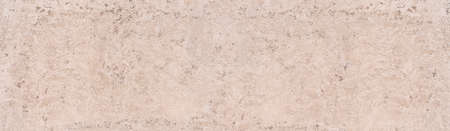 Panoramic detail of an abstract wall texture made of rough bright plaster