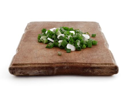 serrate: Serrated stone leek on wooden cutting board Stock Photo