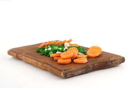 serrate: Serrate stone leek and carrot on wooden cutting board Stock Photo