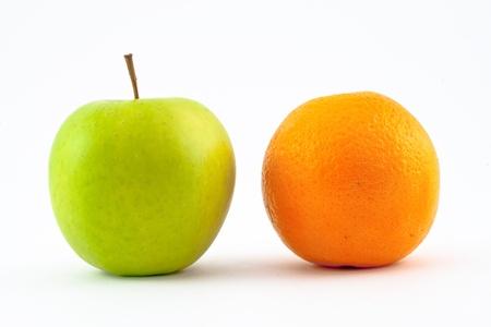 antipode: Fresh apple and orange isolated on white background