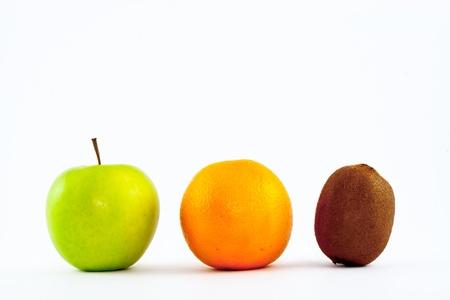 antipode: Apple, orange and kiwi isolated on white background