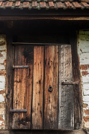 Old ruined country door on abandoned house photo