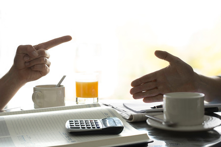 Figuring out finances, brainstorm, budget. Calculator.