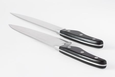 cutting edge: Two kitchen knives on wite