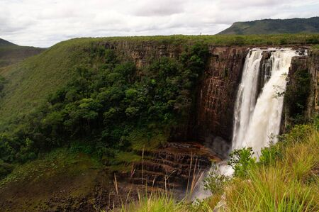 magnificent: Magnificent waterfall, salto in spanish, called Aponwao in Gran sabana, Venezuela with mountains in background Stock Photo