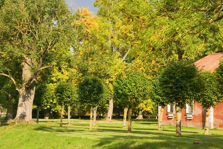 rundale: Old red hause in colorful autumn park Stock Photo