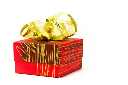 Red gift box on white background with golden bow photo
