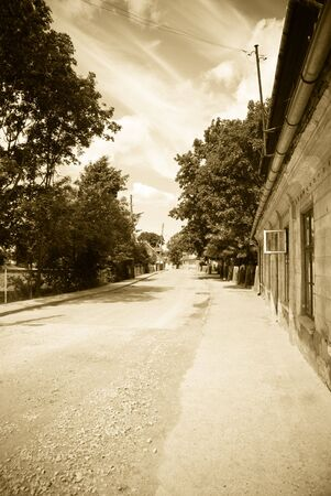 Old small street in old town. Sepia photo