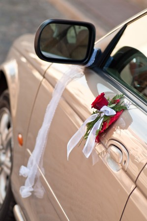 Cars side door decorated with bouquet and band Stock Photo - 7624582