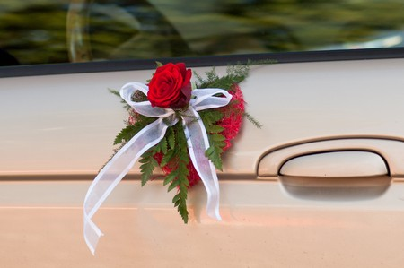 Drivers door decorated with bouquet in shape of heart photo