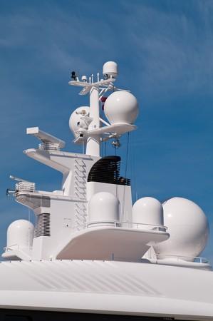 Navigation system antennas of big white motor yacht photo
