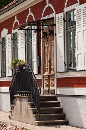 Facade of old house with steps in front of door photo