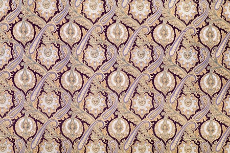 Brown background textile with arabesque style ornament photo