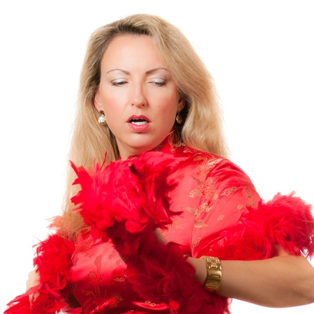 Beautiful blond caucasian woman dancing in red chinese dress cheongsam with boa in hands photo