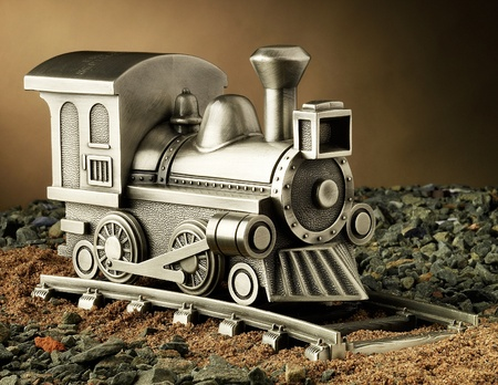 gold metal: Pewter Model Train on Tracks Stock Photo