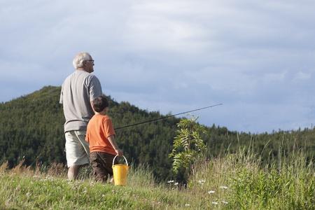senior citizen: Grandfather and Grandson Going Fishing