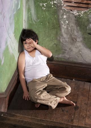 khakis: Frightened Boy in White Undershirt and Khaki Pants