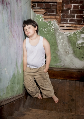 squalid: Boy in White Shirt and Khaki Pants