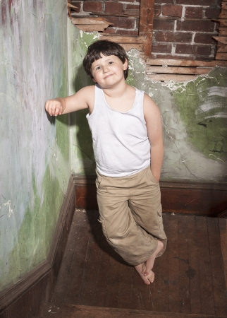 Boy in White Shirt and Khaki Pants photo