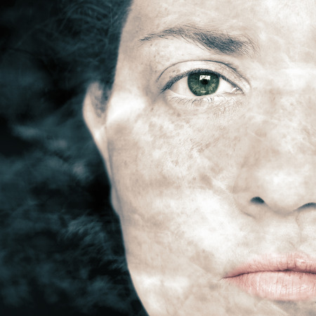 Closeup Artistic Portrait of Woman and with Smoke Superimposed Over Her Face Stock Photo