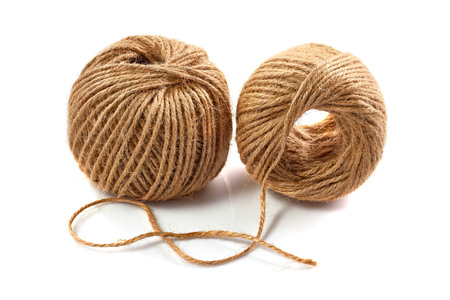 Two skeins of jute twine isolated on white background