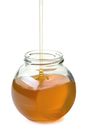 drizzler: Jar with flowing honey isolated on white background