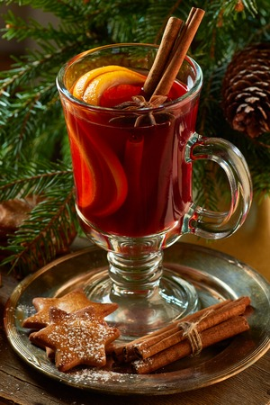 Mulled wine with cinnamon sticks, ginger cookies and spruce branches. Christmas an new year concept.