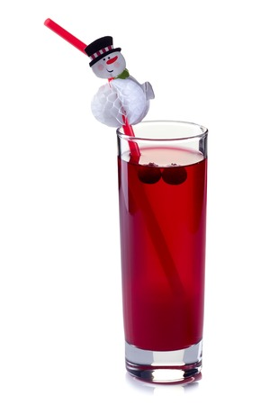 Glass of cranberry fruit drink with snowman straw isolated on white background