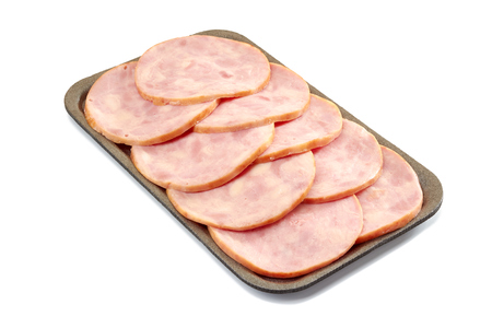 Sliced ham in retail tray on white